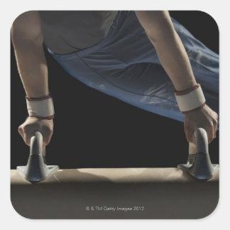 Gymnast swinging on pommel horse square sticker