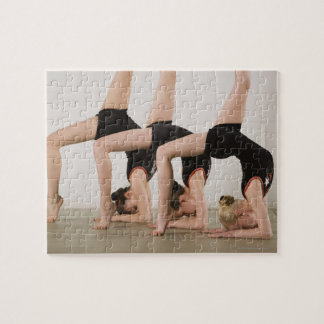 Gymnasts posing upside down puzzles