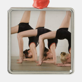 Gymnasts posing upside down Silver-Colored square decoration