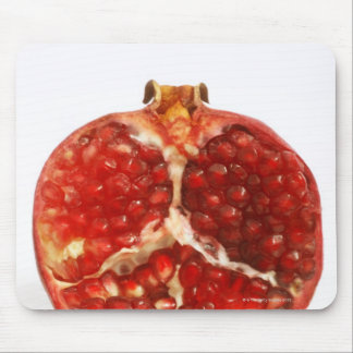 Half a ripe pomegranate cut to expose the juicy mouse mat