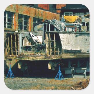 Half boat in dry dock square sticker