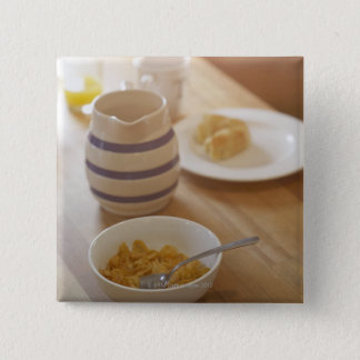 Half eaten breakfast on kitchen table 15 cm square badge