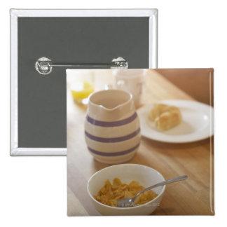 Half eaten breakfast on kitchen table 15 cm square badge