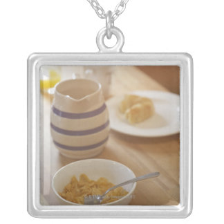 Half eaten breakfast on kitchen table silver plated necklace