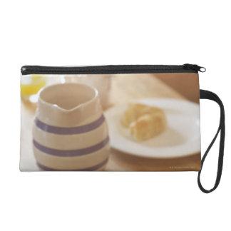 Half eaten breakfast on kitchen table wristlet purses