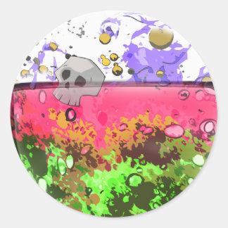 Half full glass of poison. round sticker
