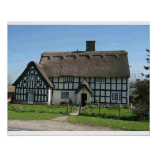 Half Timbered cottage with a thatched roof Print