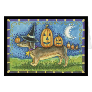 Halloween card with witches dog and pumpkins