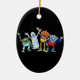 Halloween cartoon creatures waving christmas ornament
