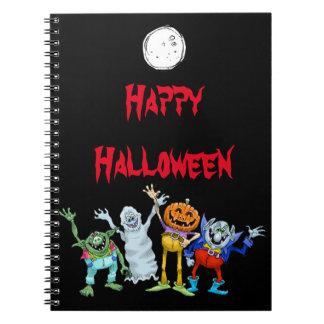 Halloween cartoon creatures waving, notebooks. notebook