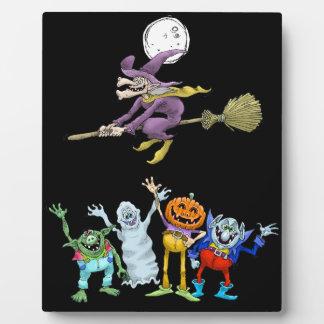 Halloween cartoon creatures waving, plaque. plaque