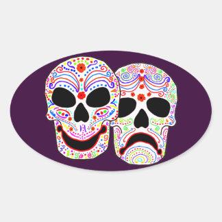 Halloween DOTD Comedy-Tragedy Skulls Oval Sticker