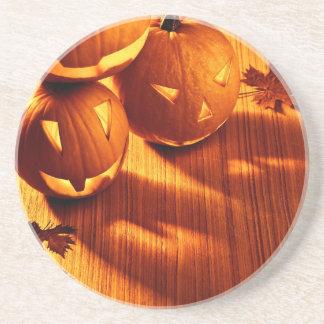 Halloween glowing pumpkins border coasters