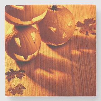 Halloween glowing pumpkins border stone beverage coaster