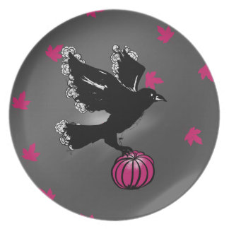 halloween illustration of a raven and a pumpkin plate