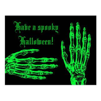Halloween neon green zombie hands postcard
