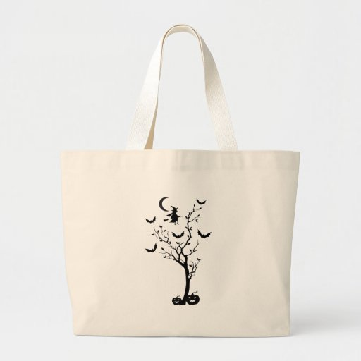 Halloween tree with flying witch and bats tote bag