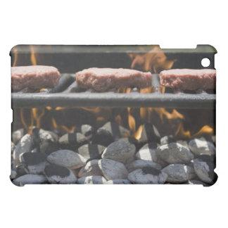 Hamburgers cooking on grill iPad mini case
