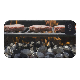 Hamburgers cooking on grill iPhone 4 cover