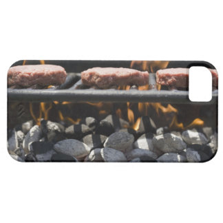 Hamburgers cooking on grill iPhone 5 cover