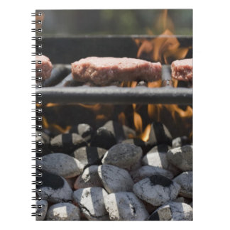 Hamburgers cooking on grill spiral notebook