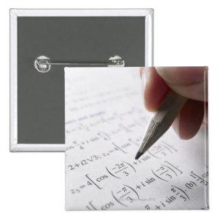 Hand doing math homework 15 cm square badge