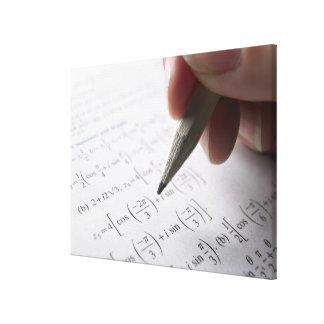Hand doing math homework canvas print