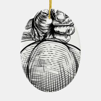 Hand Holding a Burlap Sack or Money Bag Ceramic Oval Decoration