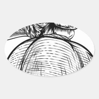 Hand Holding a Burlap Sack or Money Bag Oval Sticker