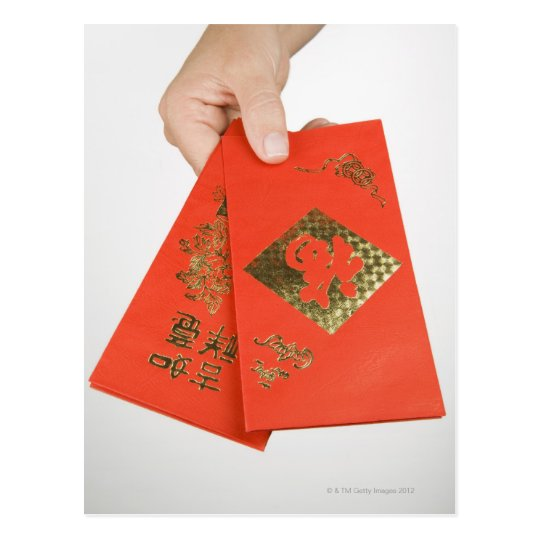 Hand holding Chinese money envelope Postcard