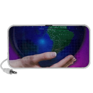 Hand holding earth iPod speakers