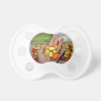 hand holding hot peppers food image baby pacifiers