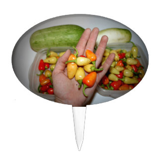 hand holding hot peppers food image cake pick