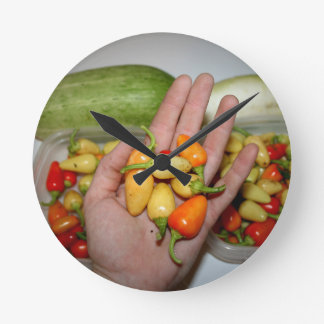hand holding hot peppers food image round clocks