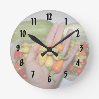 hand holding hot peppers food image clock