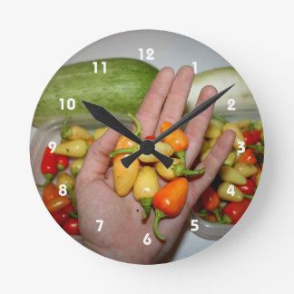 hand holding hot peppers food image wall clock