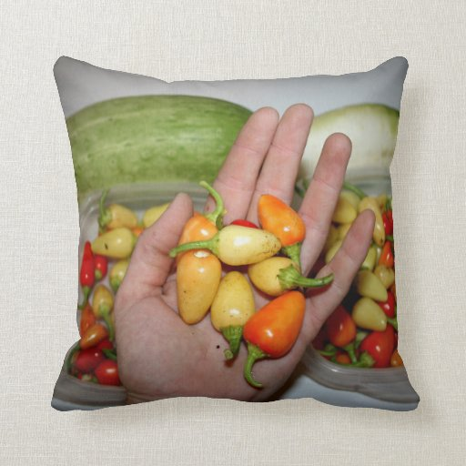 hand holding hot peppers food image throw pillows