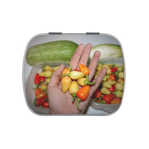 hand holding hot peppers food image candy tin