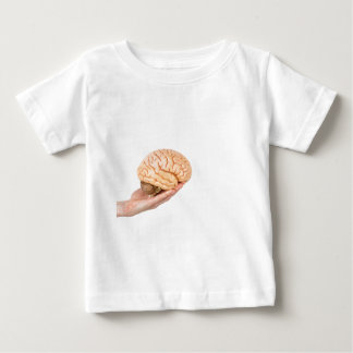 Hand holding model human brains isolated on white shirts