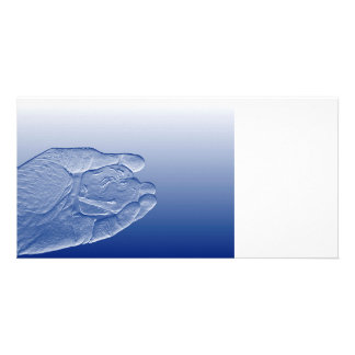 hand holding pepper raised  blue food abstract picture card