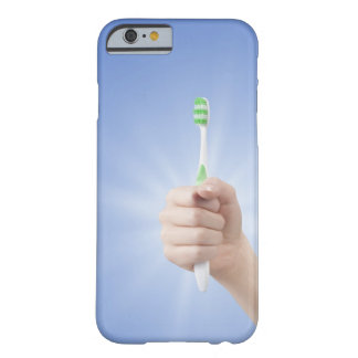 Hand holding tooth brush barely there iPhone 6 case