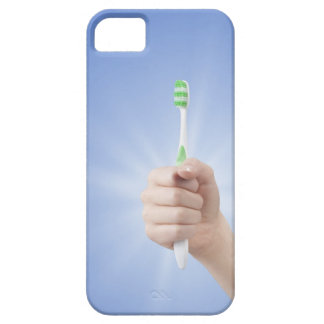Hand holding tooth brush iPhone 5 covers