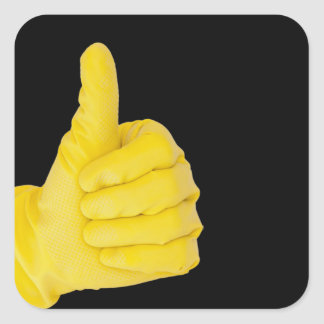 Hand in yellow latex glove square sticker