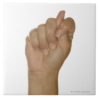Hand making T sign Tile