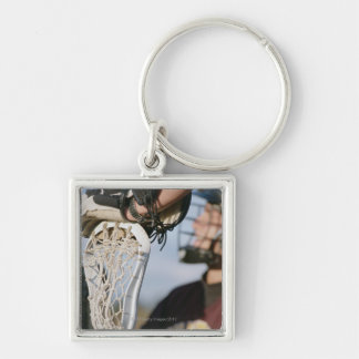 Hand on a Lacrosse Stick Keychains