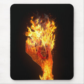 Hand on fire mouse pad
