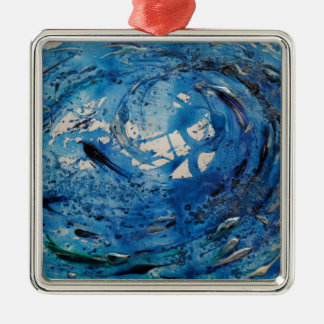 Hand painted tumbling surf wave with silvery fish christmas ornament