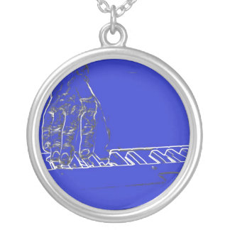 hand playing keyboard blue white ink outline round pendant necklace