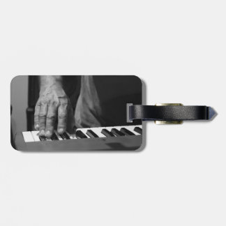hand playing keyboard bw male music luggage tag