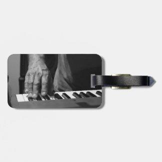 hand playing keyboard bw male music travel bag tag